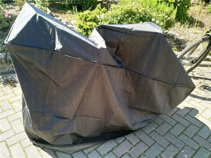 Order a Waterproof cover for bikes and bicycles. One size fits most -- dimensions: 1720mm x 620mm x 1060mm