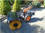 Tractor with Sweeper Attachment